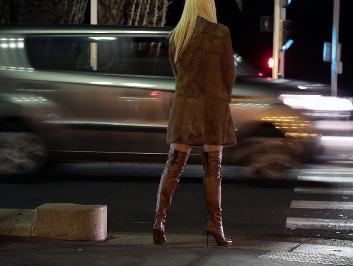 A prostitute from Eastern Europe waits for customers along the Promenade des Anglais in Nice. (Reuters)