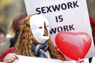 A sex worker in Paris demonstrates against plans to fine people who use prostitutes' services. (Reuters)