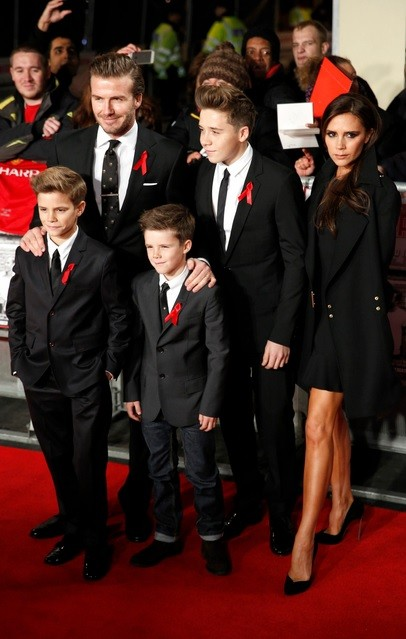 Former England soccer captain David Beckham, his wife Victoria, and their children attend the world premier of the film