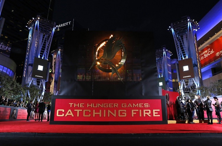 People wait at the premiere of The Hunger Games: Catching Fire in Los Angeles, California. The sequel starring Jennifer Lawrence is tipped to make $400m in the US alone. (Photo:Reuters)