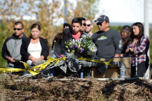 "Fans gather and place flowers at the scene of a fiery crash that killed ""Fast and Furious"" actor Paul Walker"