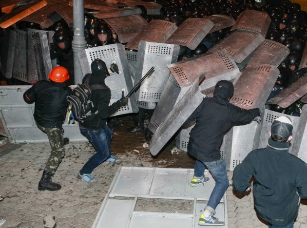 Protesters try to break through police lines near the presidential administration building during a rally held by supporters of EU integration in Kiev