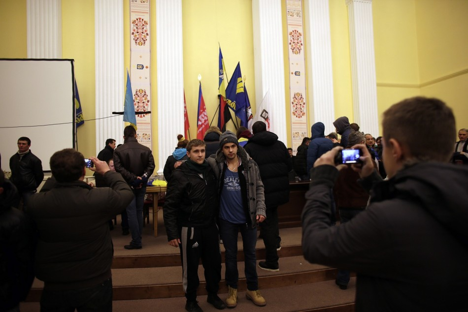 People take pictures at a meeting hall inside Kiev's city hall December 1, 2013