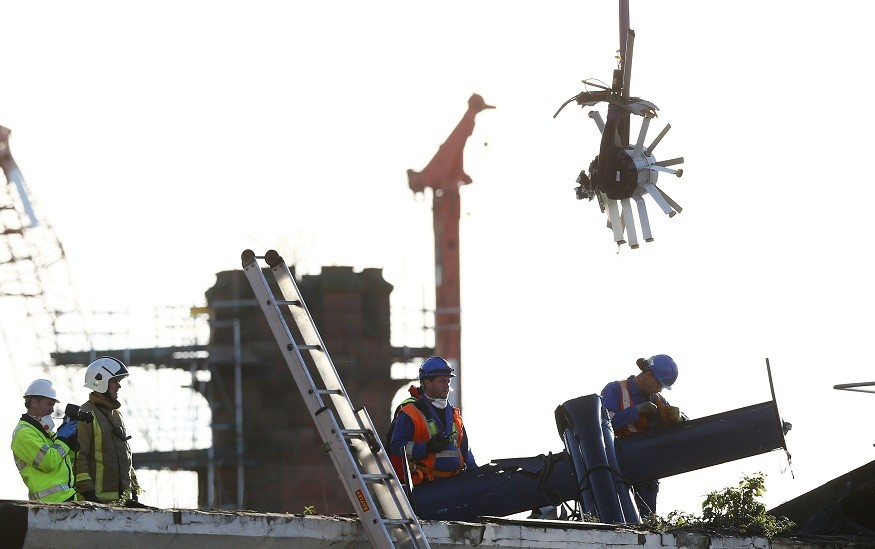Rescuers remove helicopter from the Clutha pub after tragedy in Glasgow PIC: Reuters