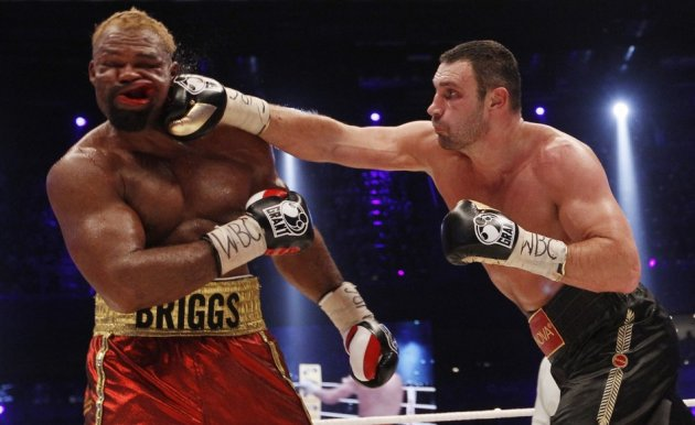 WBC boxing champion Vitali Klitschko (R) of Ukraine lands a punch on Shannon Briggs of the U.S.