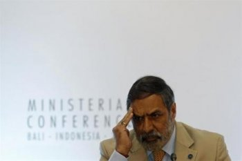 India's trade minister Anand Sharma listens during a news conference at the ninth World Trade Organization (WTO) Ministerial Conference in Nusa Dua, on the Indonesian resort island of Bali December 5, 2013.