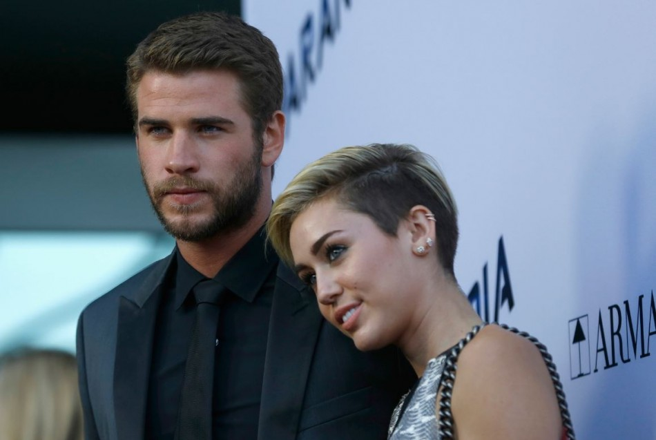 Australian actor Liam Hemsworth and Miley Cyrus during happier times.