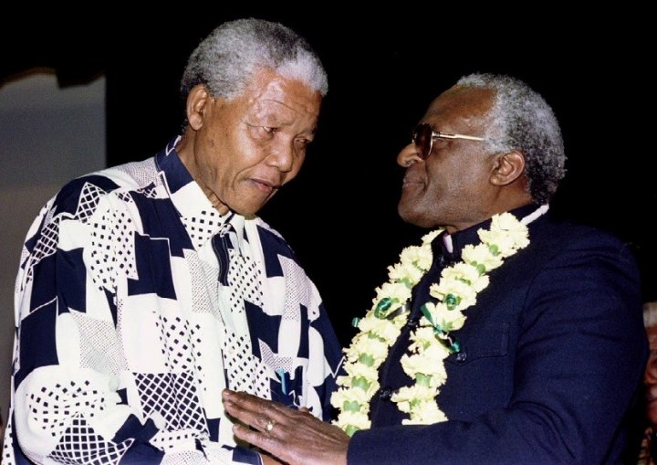 Nelson Mandela wearing a shirt to bring out the vari-focal tint in Desmond Tutu's glasses PIC: Reuters