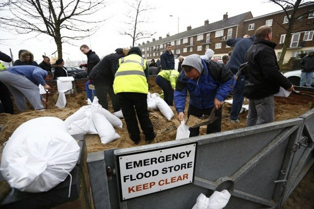 Residents fill sand bags before an expected storm surge in Great Yarmouth (Reuters)