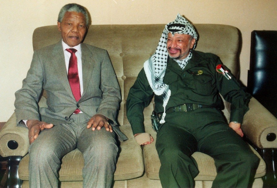 Nelson Mandela in a suit with Yasser Arafat PIC: Reuters