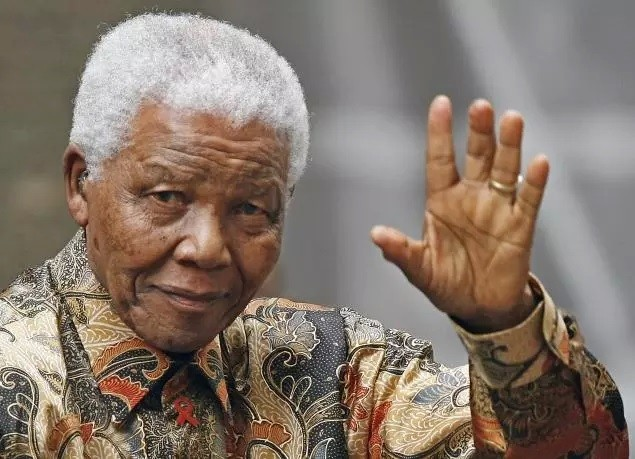 Farewell Mandela you certainly shall be missed, you shirts probably won't PIC: Reuters