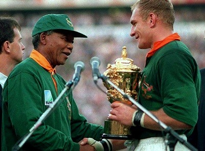 Nelson Mandela hands over the William Webb Ellis Cup to Springbok captain Francois Pienaar after South Africa's victory in the 1995 World Cup (Reuters)