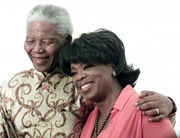 Oprah Winfrey with the late Nelson Mandela