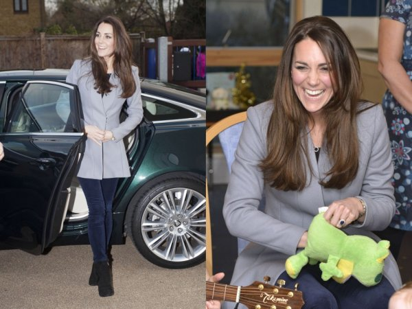 Kate wore blue skinny jeans and Reiss' gray coat for the visit. (Photo: REUTERS/Bradley Page)