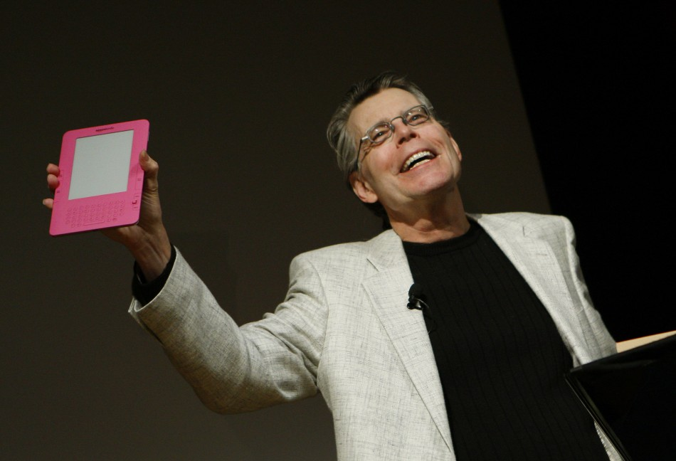 Author Stephen King holds up a pink Amazon Kindle 2 electronic reader.