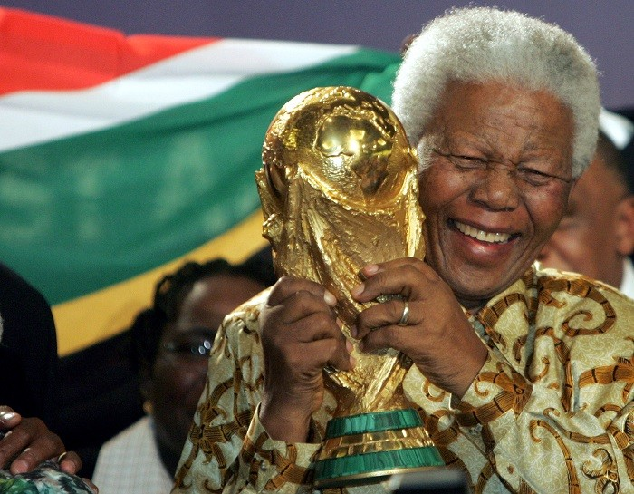 Nelson Mandela holds the World Cup trophy after South Africa is chosen to host the 2010 World Cup tournament. (Reuters)