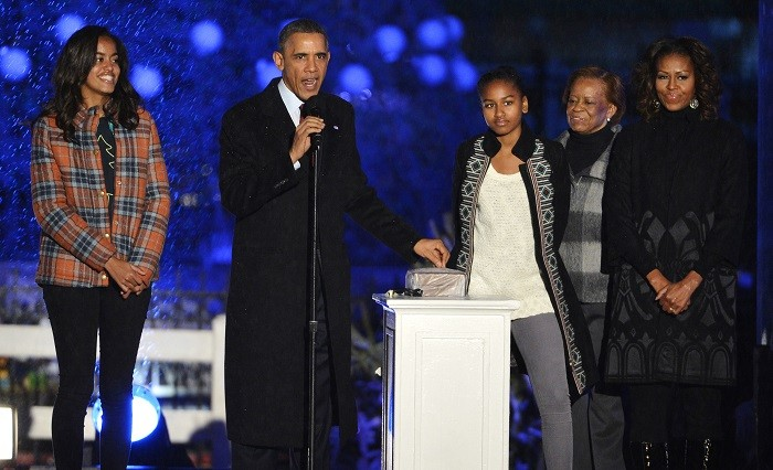 Back Obama and the first family light the national Christmas tree in a ceremony that dates back to the 1920s. (Reuters)