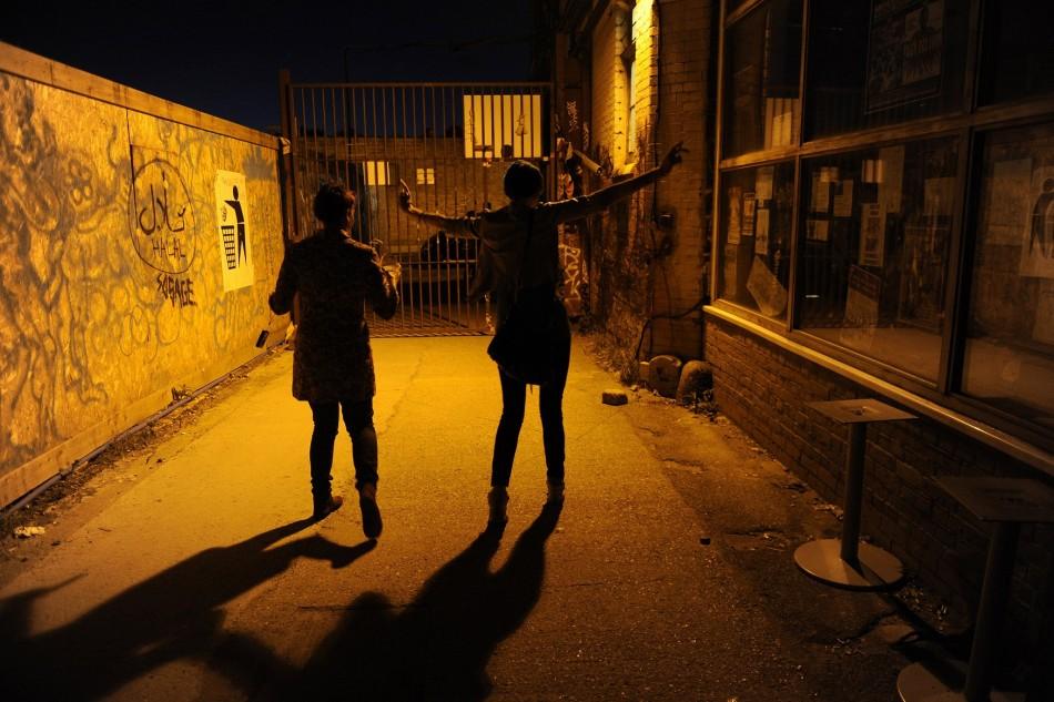 Two women leave a bar in Hackney Wick, east London.