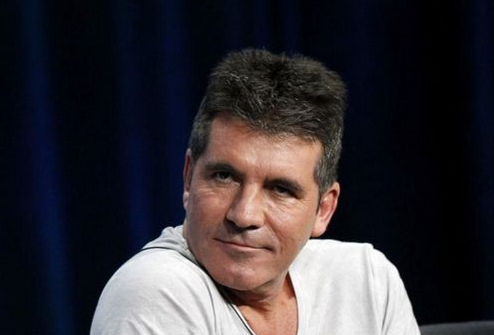 Cowell already has high hopes pinned on his yet unborn son. He wants him to work his way to success/Reuters