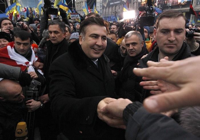 Ex-Georgian president Mikheil Saakashvili meets pro-EU demonstrators in Kiev. (Reuters)
