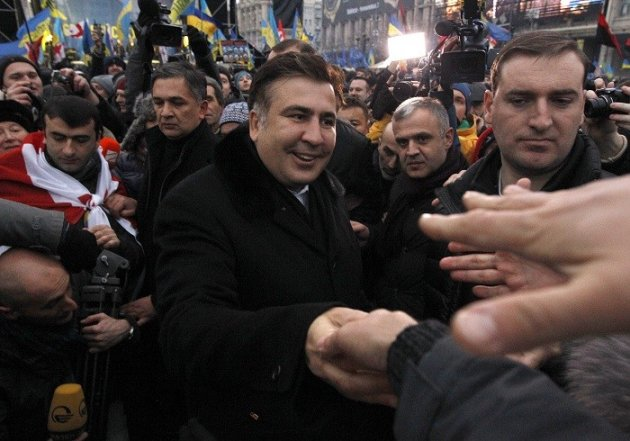 Ex-Georgian president Mikheil Saakashvili meets pro-EU demonstrators in Kiev. (Reuters)