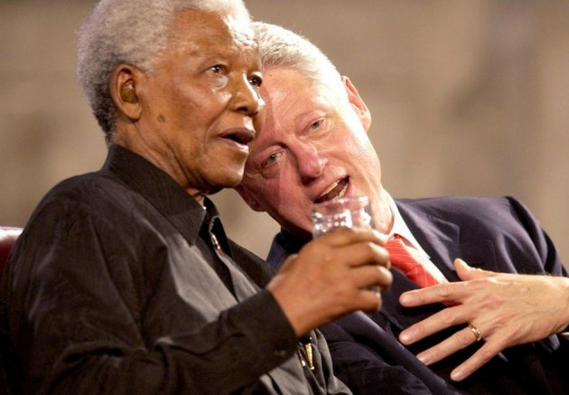 Former US President Bill Clinton (R) and former South African President Nelson Mandela (L) speak during a Gala night in Westminster Hall, London, July 2, 2003.