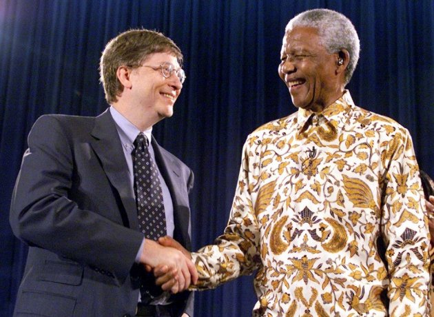 Nelson Mandela, former President of South Africa, (R) shakes hands with Bill Gates, chairman and CEO of Microsoft, at a global health discussion in Seattle in 1999.