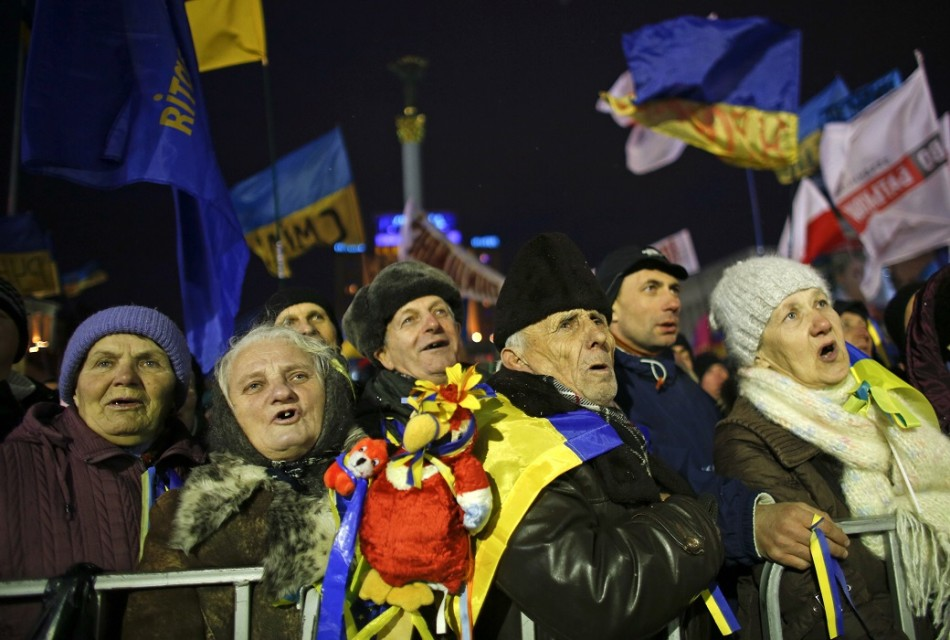 People attend a rally organized by supporters of EU integration in central Kiev.