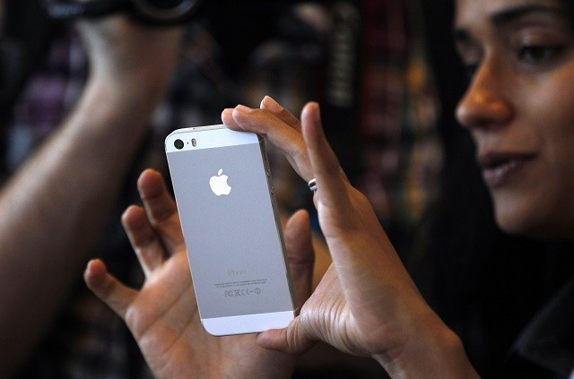 Apple iPhone 5S (Silver) in the Apple Inc's media event, 2013.