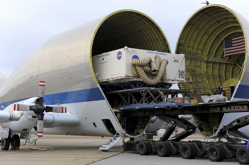 The heat shield for NASA's Orion spacecraft was loaded onto a Super Guppy plane for transport to Florida's Kennedy Space Center, in Manchester, New Hampshire, in this NASA handout photo taken December 4, 2013.