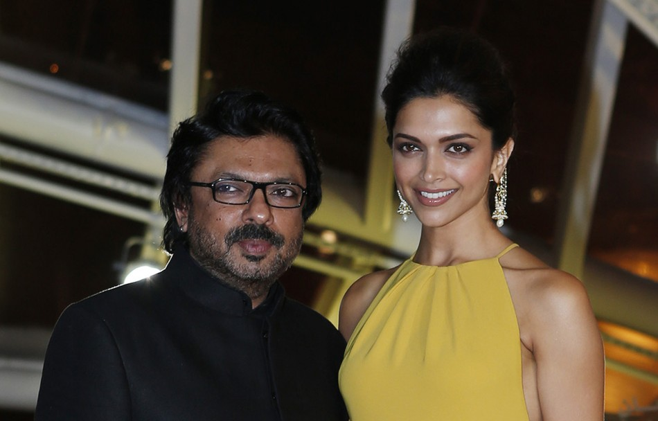 Indian actress Deepika Padukone and Indian director Sanjay Leela Bhansali (R) attend the opening of the 13th annual Marrakech International Film Festival in Marrakech November 29, 2013. (REUTERS/Youssef Boudlal)