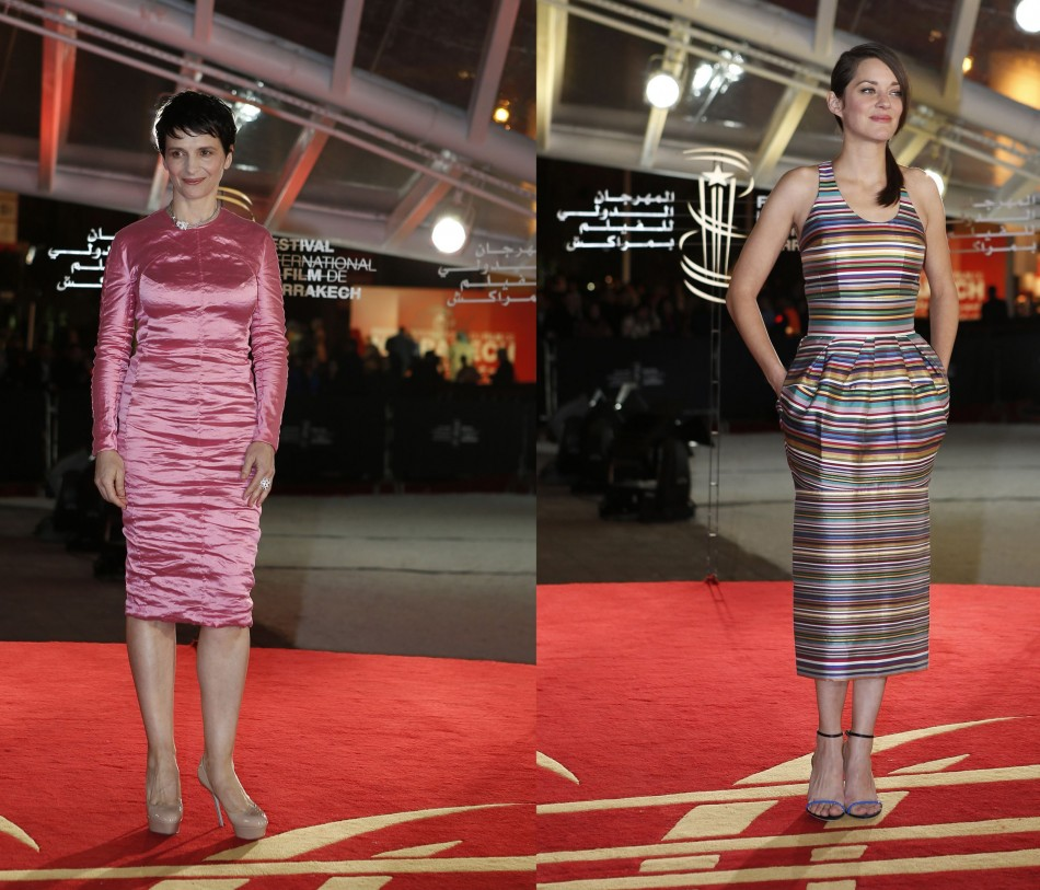French actresses: Juliette Binoche (L) wears shiny pink dress while Marion Cotillard looks chic in oddly striped dress. (Reuters)