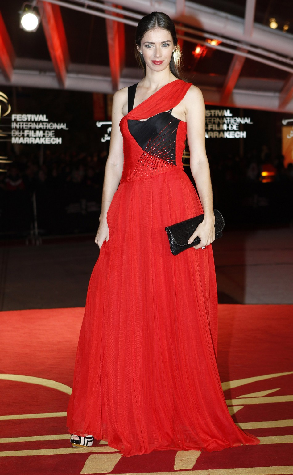 French actress Sarah Barzyk-Aubrey stuns in bold red. (Reuters)