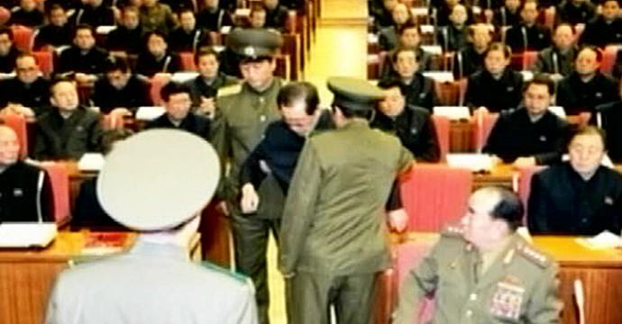 Jang being taken away by uniformed guards