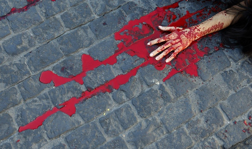 Gallons of fake blood look all too real for bus driver Vasko Petrovski in Australia PIC: Reuters