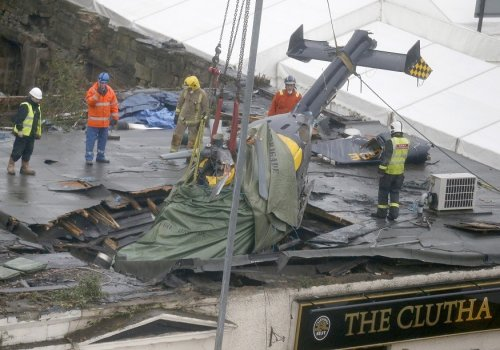 Wreck of police helicopter lodged inside The Clutha pub PIC: Reuters