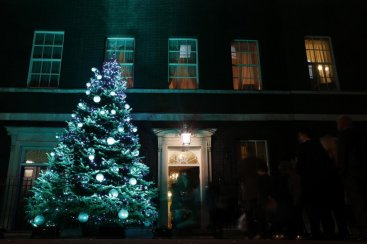 Guests from the 10 Downing Street Christmas party mill around outside