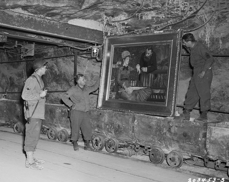 US soldiers examine the painting,
