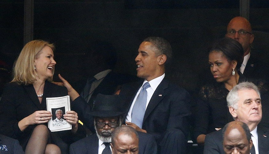 Helle Thorning-Schmidt and Barak Obama share a joke at Nelson Mandela's memorial, but Michelle's not laughing PIC: Reuters