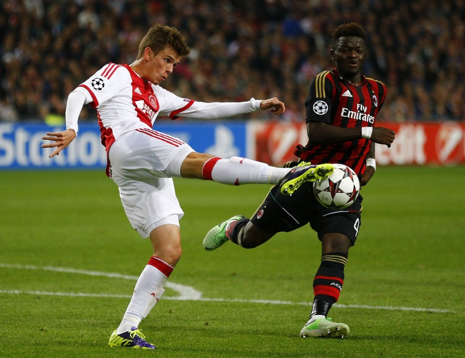 Ajax Amsterdam's Lucas Andersen (L) fights for the ball with AC Milan's Sulley Muntari (R) during their Champions League soccer match