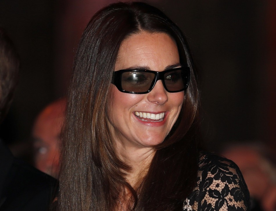 Catherine, the Duchess of Cambridge, wears 3D glasses before a screening of