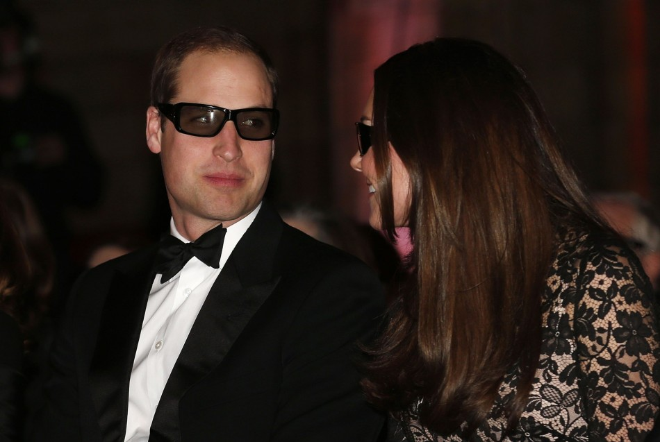 William and Kate look amused by their 3D glasses. (Reuters)