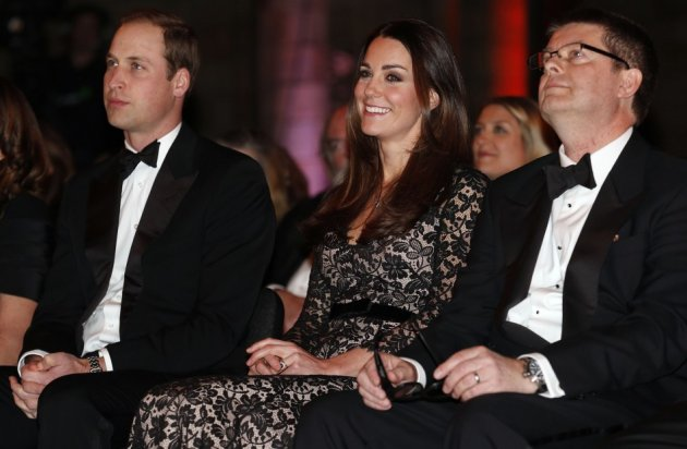 Kate enjoys screening along with Prince William and with Natural History Museum Director Michael Dixon (Reuters)