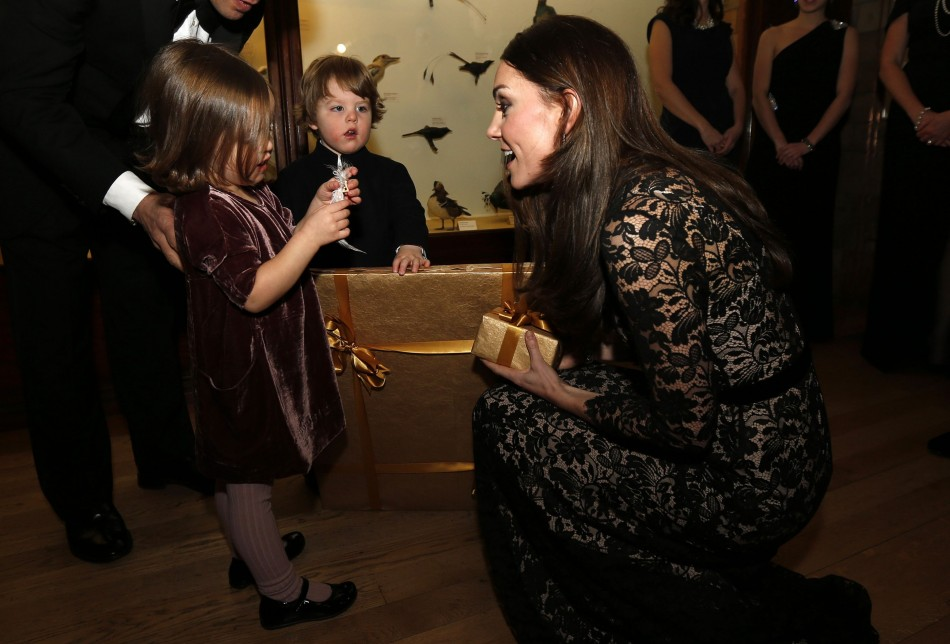 The Duchess of Cambridge, talks with Jessica (L) and her brother Francis Geffen, twin children of production company's CEO, before the screening. (Reuters)