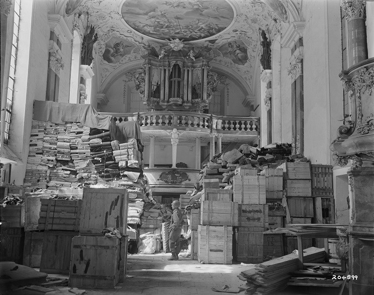 A US soldier views art stolen by the Nazi regime and stored in a church at Ellingen, Germany April 24, 1945. (Photo: Reuters)