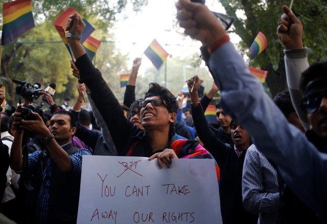 Gay rights activists wave flags and shout slogans as they attend a protest against a verdict by the Supreme Court in New Delhi December 11, 2013.
