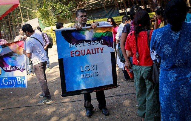 A gay rights activist folds a banner at a protest organised against the Supreme Court's order on gay sex in Mumbai December 11, 2013.