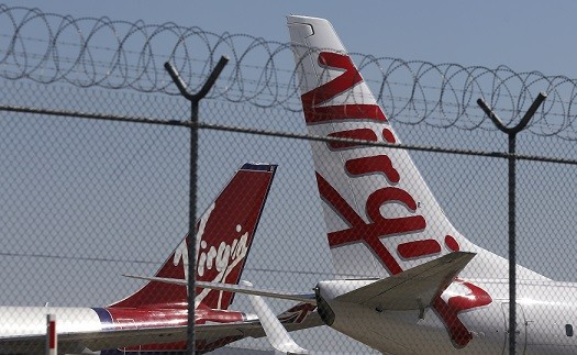Mike Dixon suffered the stroke on a Virgin flight between Las Vegas and London (Reuters)