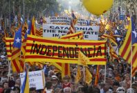 "People take to the streets with a banner reading ""independence\"" during a protest for greater autonomy for Catalonia within Spain in central Barcelona"