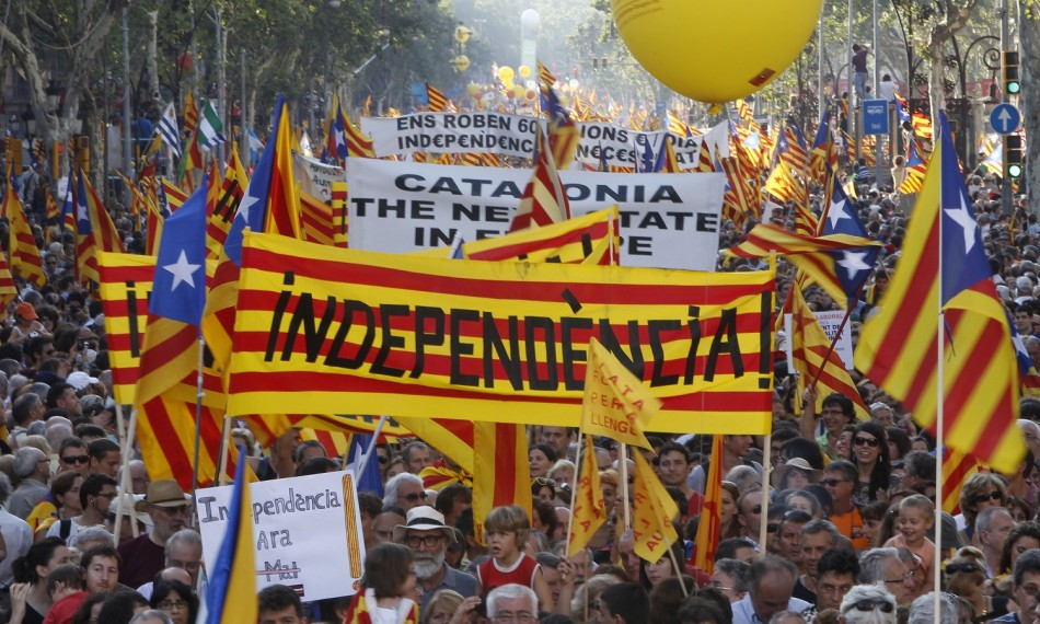 "People take to the streets with a banner reading ""independence"" during a protest for greater autonomy for Catalonia within Spain in central Barcelona"